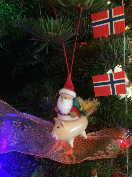Santa riding across the world on a pig?