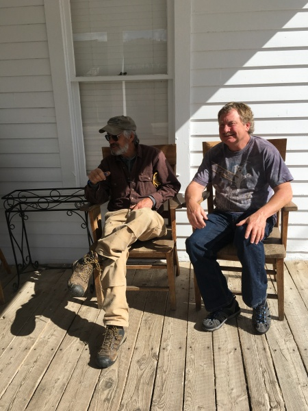 Roger and Eric chewing the fat on the front porch of Fairweather Inn